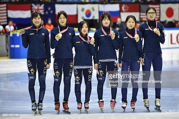 South Korea team pose with their gold medals after the Ladies' 3000m relay final on three of the ISU World Cup Short Track Speed Skating 2015 Nagoya...
