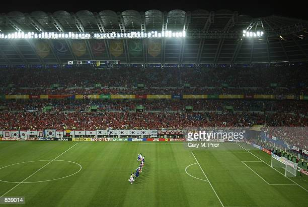 South Korea team run the length of the pitch to salute their fans after victory in the FIFA World Cup Finals 2002 Second Round match between South...