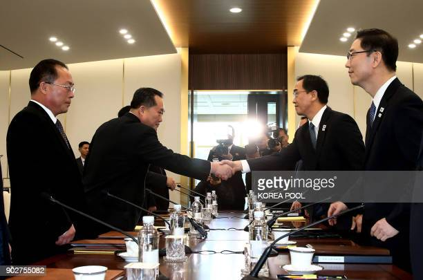 South Korea Unification Minister Cho MyungGyun shakes hands with North Korean chief delegate Ri SonGwon during their meeting at the border truce...