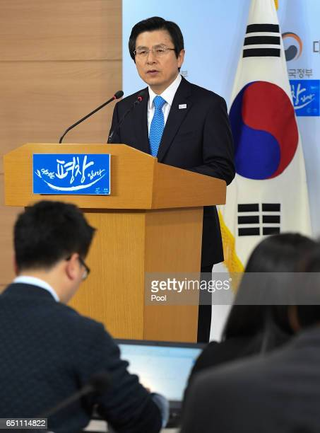 South Korean acting President and Prime Minister Hwang Kyoahn speaks to the nation during a press conference at the government complex on March 10...