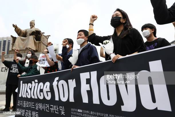 South Korean activists gather to mourn the death of George Floyd and show solidarity with the Black Lives Matter movement near the US embassy on June...
