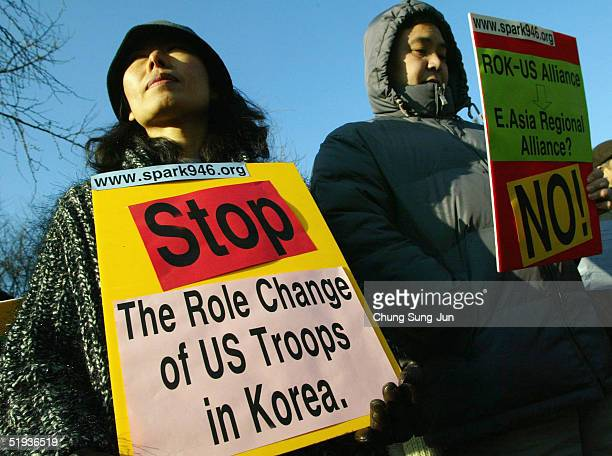 South Korean activists hold antiUS placards at a rally near the US embassy on January 11 2005 in Seoul South Korea Protesters rallied near the...