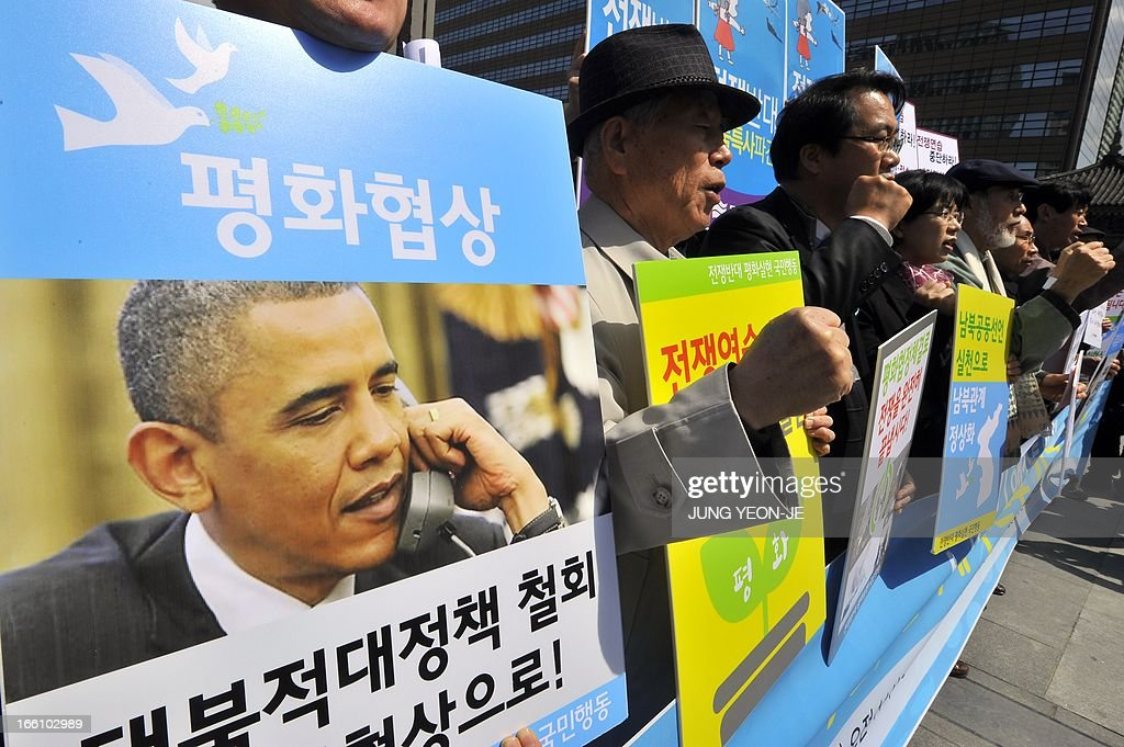 South Korean activists hold placards reading 'peace talks' and showing a picture of US President Barack Obama (L) during an anti-war rally urging peace talks with North Korea in Seoul on April 9, 2013. North Korean workers failed to report to work on April 9 at the joint Kaesong industrial zone with South Korea after Pyongyang suspended operations, upping the pressure on Seoul in an escalating military crisis.