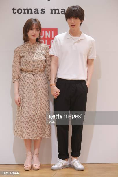 South Korean actor Ahn JaeHyun and his wife actress Ku HyeSun attend the photocall for the 'Uniqlo' tomas maier collection launch on May 31 2018 in...