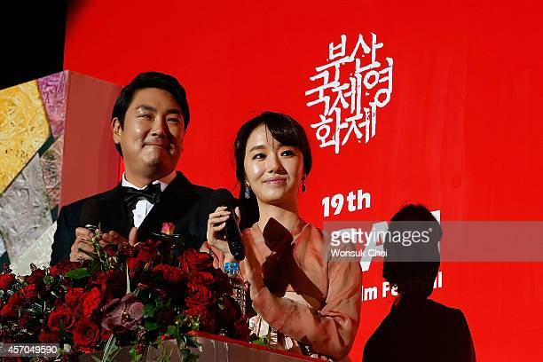 South Korean actor Cho JinWoong and actress Lee JungHyun attend the closing ceremony of the 19th Busan International Film Festival at the Busan...