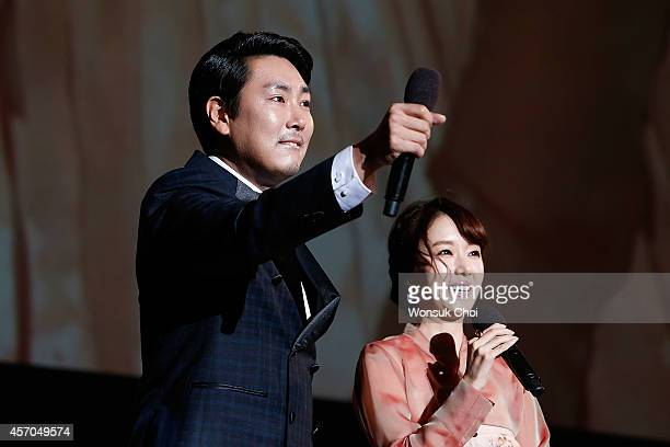 South Korean actor Cho JinWoong and actress Lee JungHyun speak during the closing ceremony of the 19th Busan International Film Festival at the Busan...
