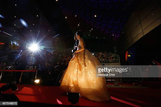 South Korean Actor Cho JinWoong and actress Lee JungHyun walk on the redcarpet during the closing ceremony of the 19th Busan International Film...