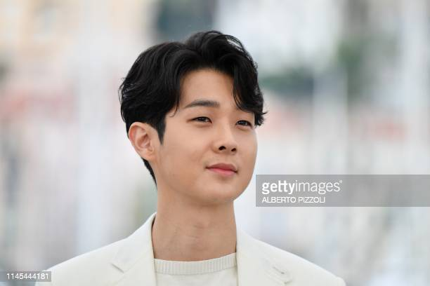 South Korean actor Choi Wooshik poses during a photocall for the film Parasite at the 72nd edition of the Cannes Film Festival in Cannes southern...