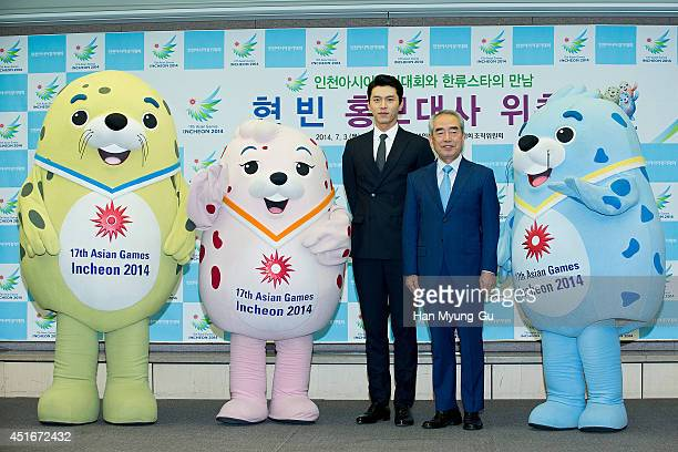 South Korean actor Hyun Bin and Kim YoungSoo President of 2014 Incheon Asian Games Organizing Committee attend the press conference for the...