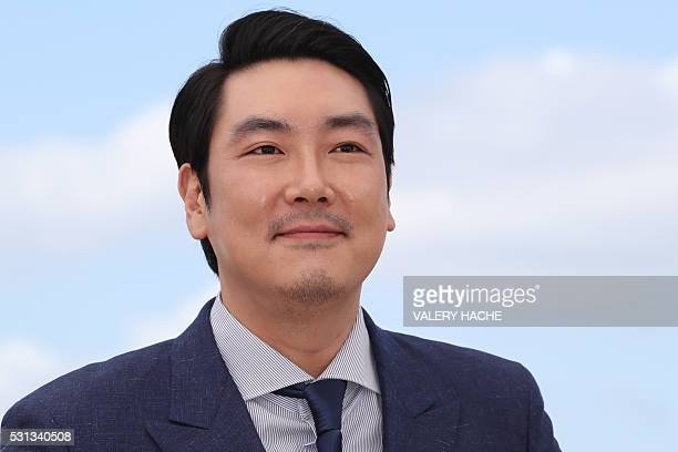South Korean actor Jo JingWoong poses on May 14 2016 during a photocall for the film The Handmaiden at the 69th Cannes Film Festival in Cannes...