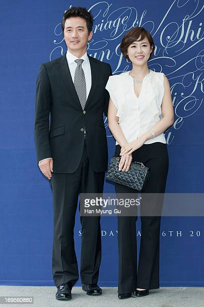 South Korean actor Jung JoonHo and TV personality Lee HaJung attend during the wedding of Shin HyunJun at the Grand Hyatt Hotel on May 26 2013 in...