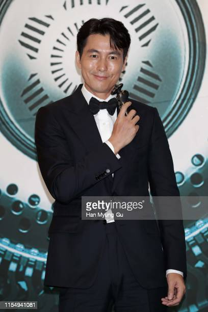 South Korean actor Jung WooSung poses for media during as he holds S9000 Prestige at PHILIPS Korea PopUp Store Opening at Lotte Department Store on...