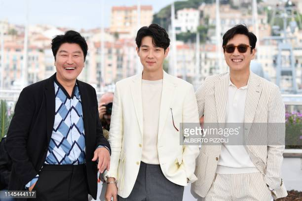 South Korean actor Kangho Song South Korean actor Choi Wooshik and South Korean actor Lee Sunkyun pose during a photocall for the film Parasite at...