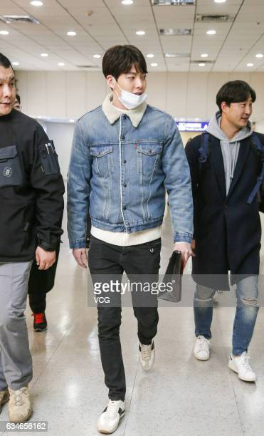 South Korean actor Kim Woo Bin arrives at Taoyuan International Airport on February 10 2017 in Taipei Taiwan of China