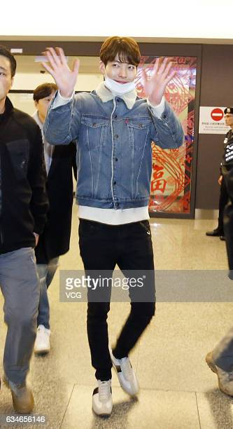 South Korean actor Kim Woo Bin waves to fans at Taoyuan International Airport on February 10 2017 in Taipei Taiwan of China