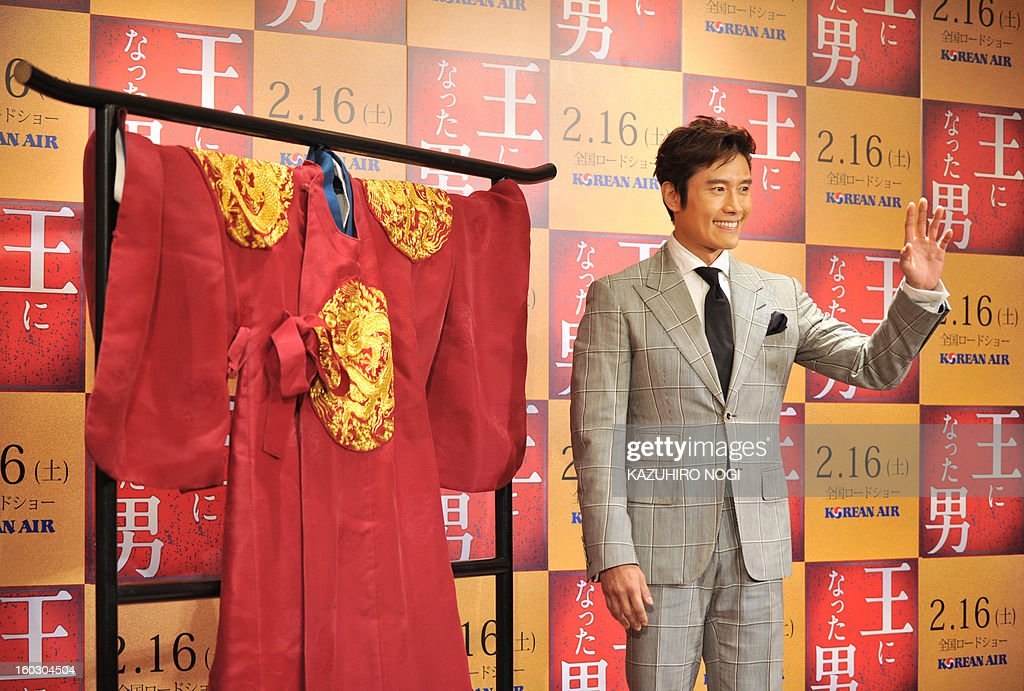 South Korean actor Lee Byung-Hun poses next to a costume (L) on display during a photo session after a press conference to promote his latest film 'Gwanghae: the Man Who Became King' in Tokyo on January 29, 2013. The film will open in Japan on February 16.