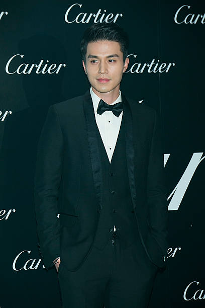South Korean actor Lee DongWook poses for photographs 'Cartier' Panthere 100th Anniversary at Walkerhill Hotel on October 16 2014 in Seoul South Korea
