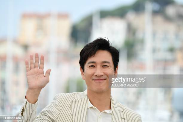 South Korean actor Lee Sunkyun poses during a photocall for the film Parasite at the 72nd edition of the Cannes Film Festival in Cannes southern...