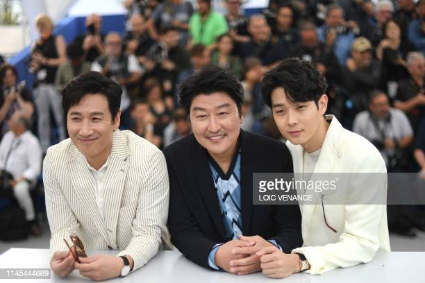 South Korean actor Lee Sunkyun South Korean actor Kangho Song and South Korean actor Choi Wooshik pose during a photocall for the film Parasite at...