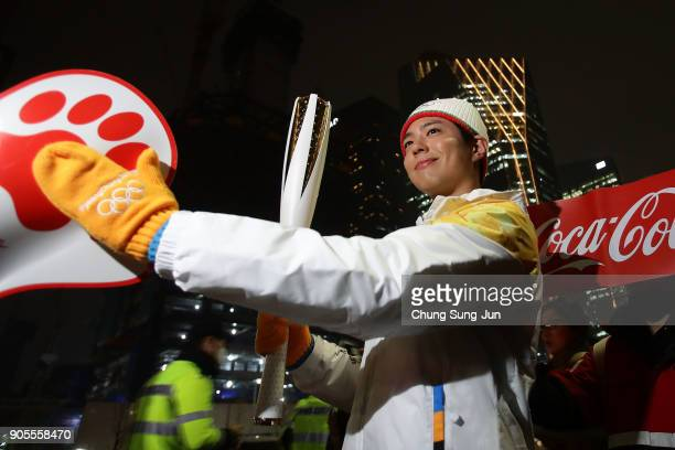 South Korean actor Park BoGum holds the PyeongChang 2018 Winter Olympics torch during the PyeongChang 2018 Winter Olympic Games torch relay on...