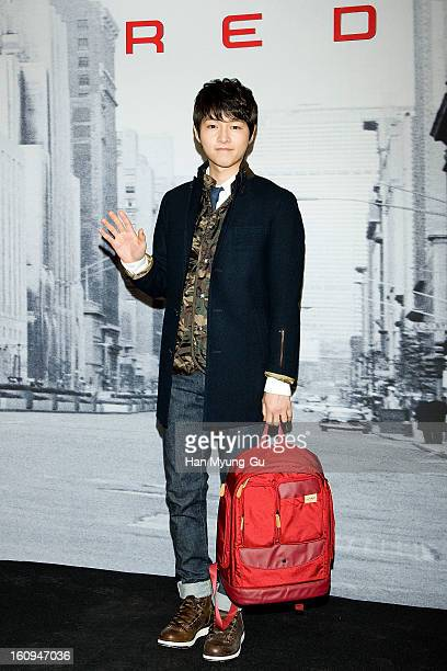 South Korean actor Song JoongKi attends a promotional event for the 'Samsonite RED' Launching on February 7 2013 in Seoul South Korea