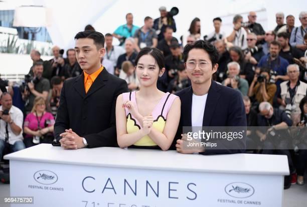 South Korean actor Yoo Ahin South Korean actress Jun Jong Seo and USSouth Korean actor Steven Yeun attend the 'Burning' Photocall during the 71st...