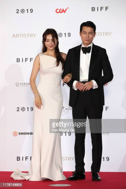 South Korean actors Lee HaNee and Jung WooSung arrive at the opening ceremony of the 24th Busan International Film Festival on October 03 2019 in...