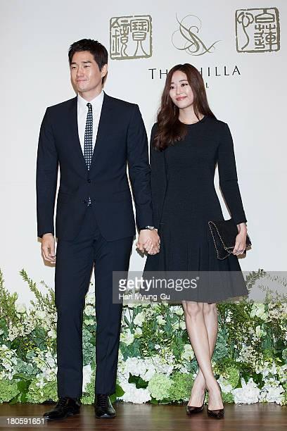 South Korean actors Yoo JiTae and Kim HyoJin attend the wedding of Bae SooBin at The Shilla Hotel on September 14 2013 in Seoul South Korea