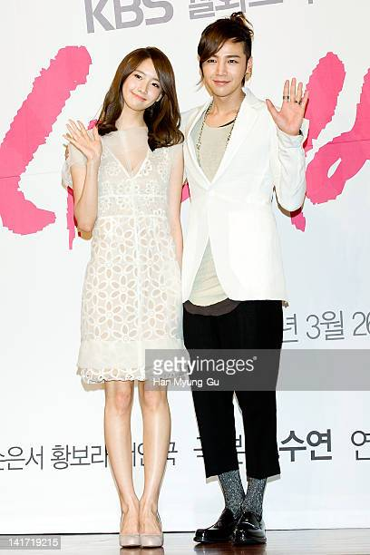 South Korean actors Yoona of K-Pop girl group Girls' Generation and Jang Geun-Suk attends a press conference to promote KBS drama 'Love Rain' at...