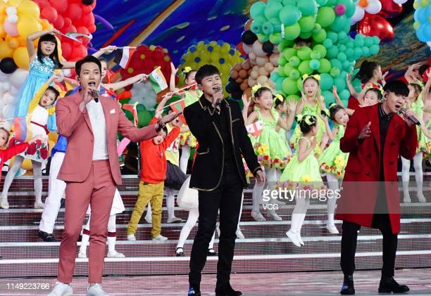 South Korean actor/singer Rain , singer Jason Zhang Jie and singer JJ Lin perform onstage during a dress rehearsal for Asian Culture Carnival on May...