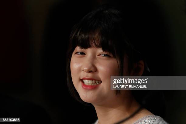South Korean actress Ahn Seohyun smiles as she attends on May 19 2017 a press conference for the film 'Okja' at the 70th edition of the Cannes Film...