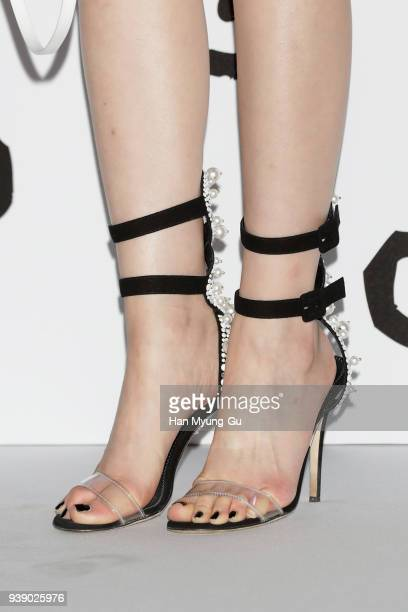 South Korean actress Ahn SoHee shoe detail attends the photocall for '10 Corso Como' Seoul on March 27 2018 in Seoul South Korea