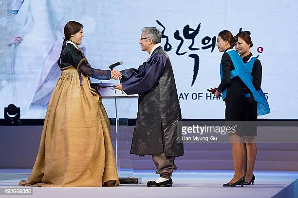 South Korean actress Ha JiWon and Kim JongDeok Minister of Cluture Sports and Tourism attend the The Day Of Hanbok 2015 at Gyeongbokgung Palace on...