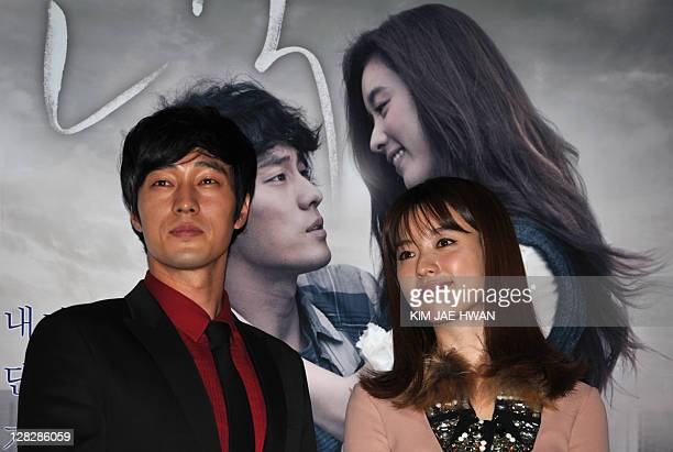 South Korean actress Han HyoJoo and actor So JiSub from the film 'Always' pose for a photograph during a press conference at the 16th Busan...