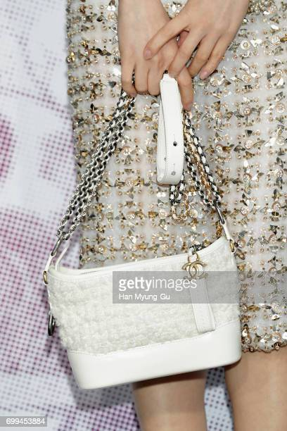 South Korean actress Han YaeRi bag detail attends the 'Mademoiselle Prive' exhibition at the DMuseum on June 21 2017 in Seoul South Korea