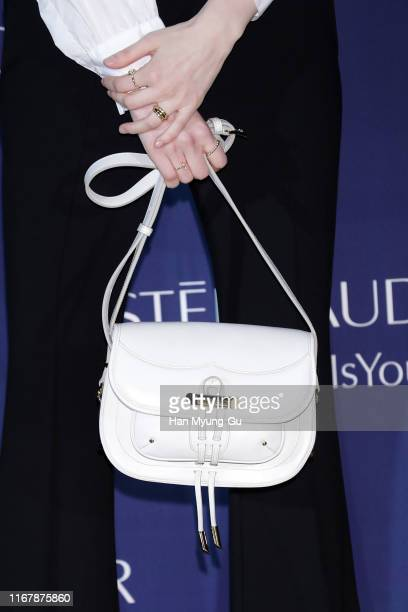 South Korean actress Jung Eun-Chae, purse detail, attends the photocall for 'Estee Lauder' at the Shilla hotel on August 13, 2019 in Seoul, South...