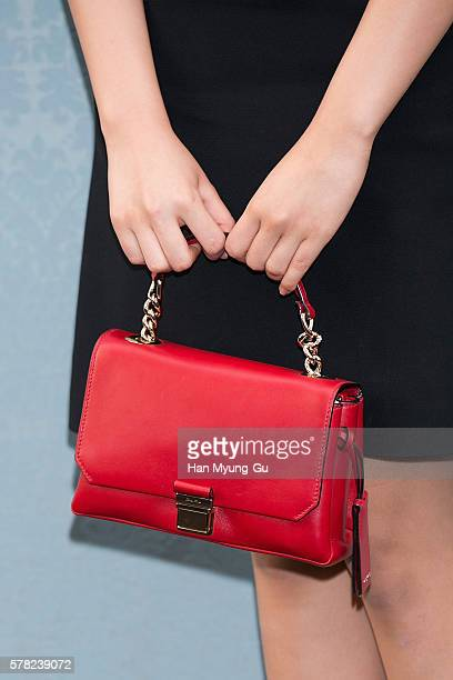 South Korean actress Kim SoHyun bag detail attends the opening event for the Miu Miu Cheongdam Boutique on July 20 2016 in Seoul South Korea