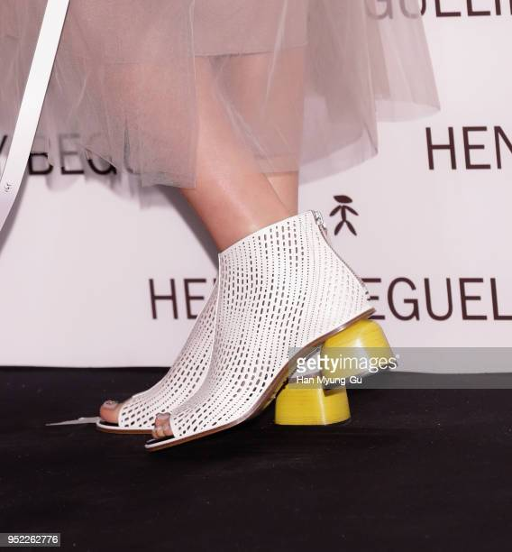 South Korean actress Kim SungRyung shoe detail attends the photocall for 'Henry Beguelin' launch on April 26 2018 in Seoul South Korea
