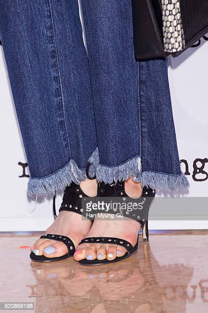 South Korean actress Lee DaHee shoe detail attends the photocall for Rouge and Lounge at Lotte Department Store on April 12 2016 in Seoul South Korea