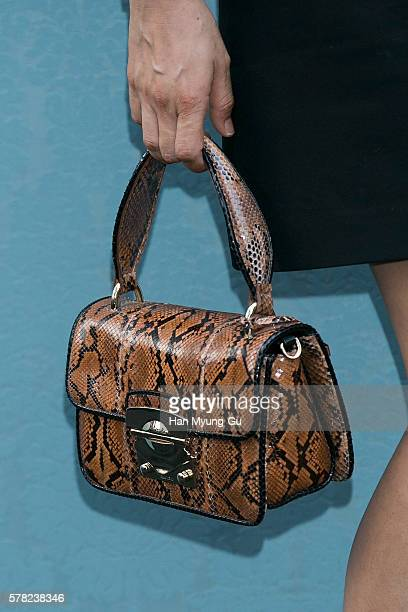 South Korean actress Lee HyeYoung bag detail attends the opening event for the Miu Miu Cheongdam Boutique on July 20 2016 in Seoul South Korea