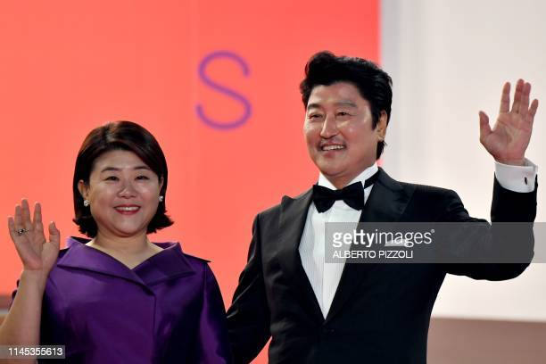 South Korean actress Lee JungEun and South Korean actor Kangho Song arrive for the screening of the film Parasite at the 72nd edition of the Cannes...
