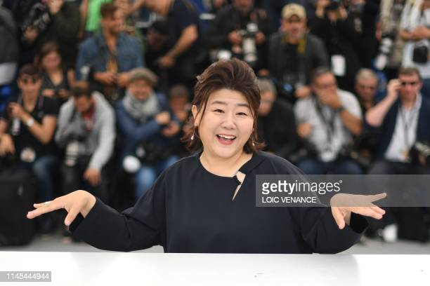 South Korean actress Lee JungEun poses during a photocall for the film Parasite at the 72nd edition of the Cannes Film Festival in Cannes southern...