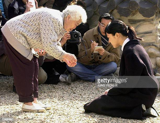 South Korean actress Lee SeungYeon apologies to a former South Korean 'comfort woman' at her house in Gwangju 17 February 2004 Lee an actress and...