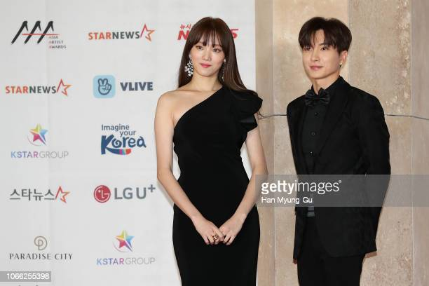 South Korean actress Lee Sung-Kyung and Leeteuk of South Korean boy band Super Junior attend the 2018 Asia Artist Awards on November 28, 2018 in...