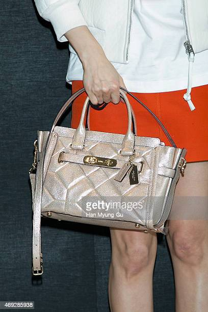 South Korean actress Park SiYeon bag detail attends the renewal opening for the COACH at Lotte Department Store on April 10 2015 in Seoul South Korea