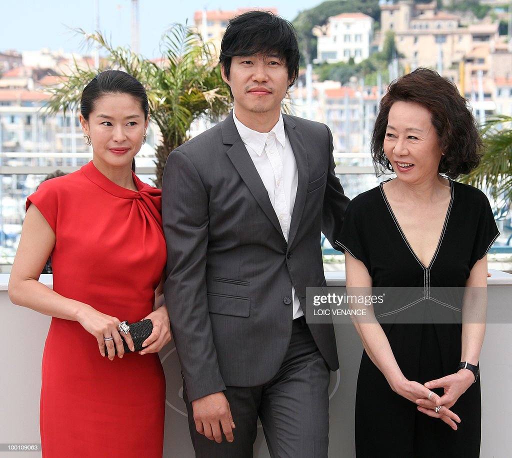 South Korean actress Ye Jiwon (L), South Korean actor Yu Joonsang and South Korean actress Youn Yuh-jung pose during the photocall 'Ha Ha Ha' presented in the Un Certain Regard selection at the 63rd Cannes Film Festival on May 21, 2010 in Cannes.