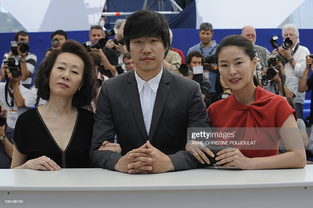 South Korean actress Youn Yuh-jung (L), South Korean actor Yu Joonsang and South Korean actress Ye Jiwon pose during the photocall 'Ha Ha Ha' presented in the Un Certain Regard selection at the 63rd Cannes Film Festival on May 21, 2010 in Cannes.