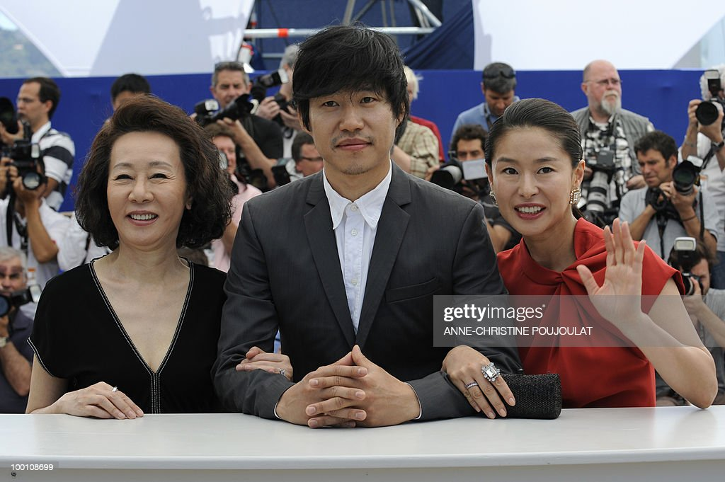 South Korean actress Youn Yuh-jung (L), South Korean actress Ye Jiwon and South Korean actor Yu Joonsang during the photocall 'Ha Ha Ha' presented in the Un Certain Regard selection at the 63rd Cannes Film Festival on May 21, 2010 in Cannes.