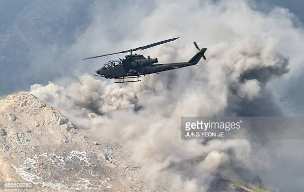 A South Korean AH1S Cobra helicopter participates in a joint live firing drill between South Korea and the US at the Seungjin Fire Training Field in...