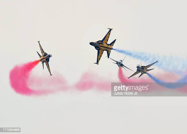South Korean Air Force acrobatic team Black Eagles perform during a ceremony for a reenactment of the battle of Chuncheon at the beginning of the...